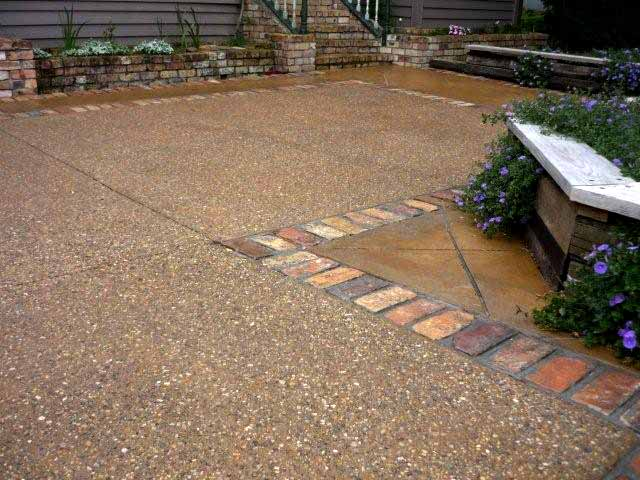 Exposed Sunburst Pebble - Brick Border